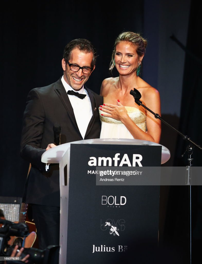 Model <a gi-track='captionPersonalityLinkClicked' href=/galleries/search?phrase=Heidi+Klum&family=editorial&specificpeople=178954 ng-click='$event.stopPropagation()'>Heidi Klum</a> and amfAR chairman Kenneth Cole speak on stage during amfAR's 20th Annual Cinema Against AIDS during The 66th Annual Cannes Film Festival at Hotel du Cap-Eden-Roc on May 23, 2013 in Cap d'Antibes, France.