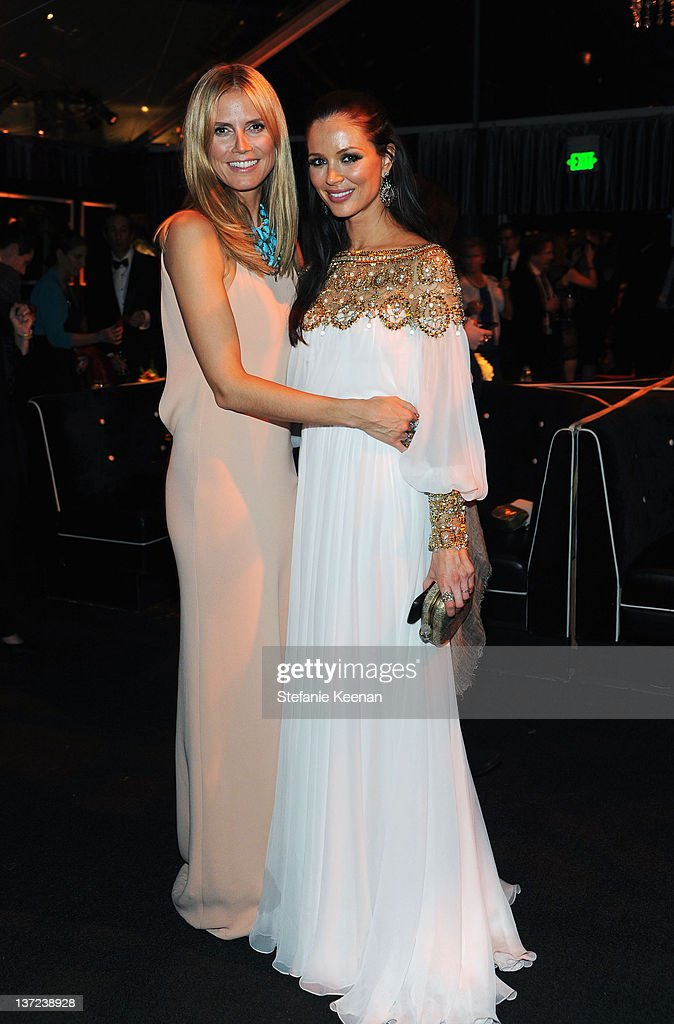 Model <a gi-track='captionPersonalityLinkClicked' href=/galleries/search?phrase=Heidi+Klum&family=editorial&specificpeople=178954 ng-click='$event.stopPropagation()'>Heidi Klum</a> and designer Georgina Chapman attend The Weinstein Company Celebration of the 2012 Golden Globes presented by Chopard held at The Beverly Hilton hotel on January 15, 2012 in Beverly Hills, California.