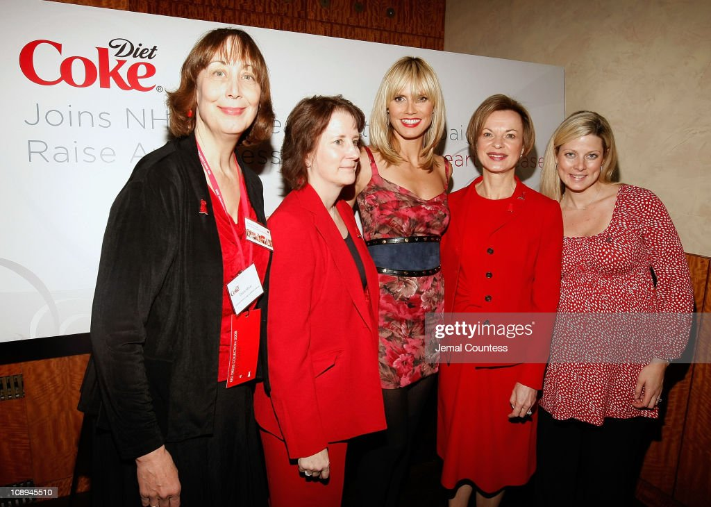 Model Heidi Klum and Dr Elizabeth Nabel with the woman of the NHLBI at a post show reception sponsored by 'The Heart Truth' Association and 'Woman...