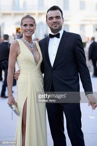 Model Heidi Klum and guest attend the amfAR's 23rd Cinema Against AIDS Gala at Hotel du CapEdenRoc on May 19 2016 in Cap d'Antibes France
