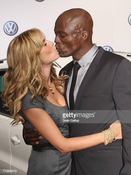 Model Heidi Klum and singer Seal kiss at a photocall to present the new Volkswagen Tiguan SUV September 27 2007 in Berlin Germany