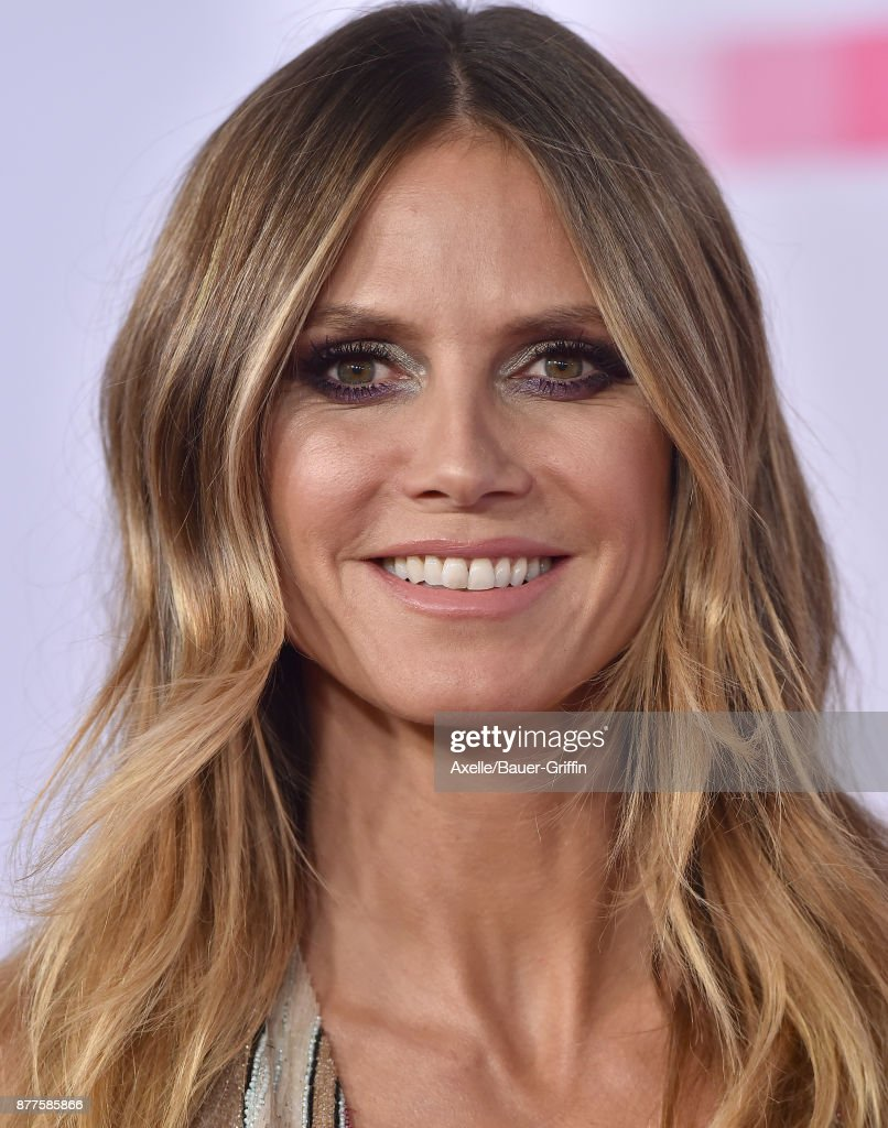 Model Heidi Klum arrives at the 2017 American Music Awards at Microsoft Theater on November 19, 2017 in Los Angeles, California.