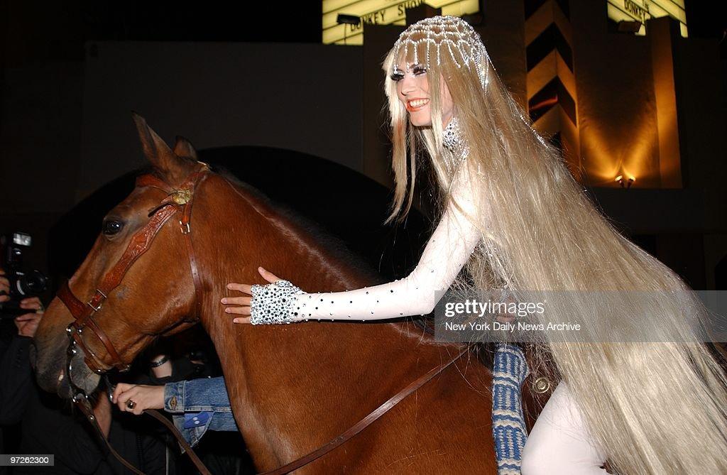 Model Heidi Klum arrives dressed as Lady Godiva on horseback at her Halloween party at Lot 61