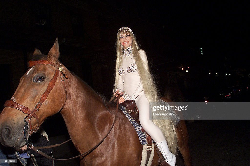 Model Heidi Klum arrives on horseback as Lady Godiva at her Annual Halloween Party at Lot 61 in New York City Photo Evan Agostini/Getty Images