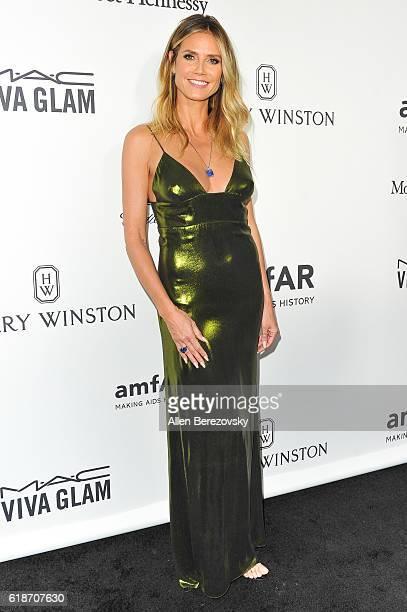 Model Heidi Klum attends amfAR's Inspiration Gala Los Angeles at Milk Studios on October 27 2016 in Hollywood California