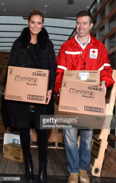 Model Heidi Klum is seen with American Red Cross CEO Josh Lockwood as she teams up with friends at AOL Patch and The American Red Cross to benefit...