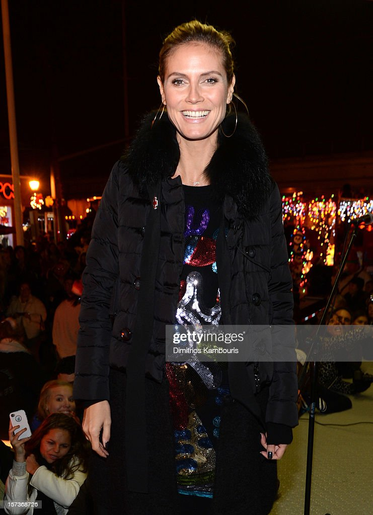 Model <a gi-track='captionPersonalityLinkClicked' href=/galleries/search?phrase=Heidi+Klum&family=editorial&specificpeople=178954 ng-click='$event.stopPropagation()'>Heidi Klum</a> participates in a tree lighting ceremony as she teams up with friends at AOL, Patch and The American Red Cross to benefit Hurricane Sandy relief efforts at American Red Cross and Patch Sites on December 2, 2012 in Lindenhurst, New York.