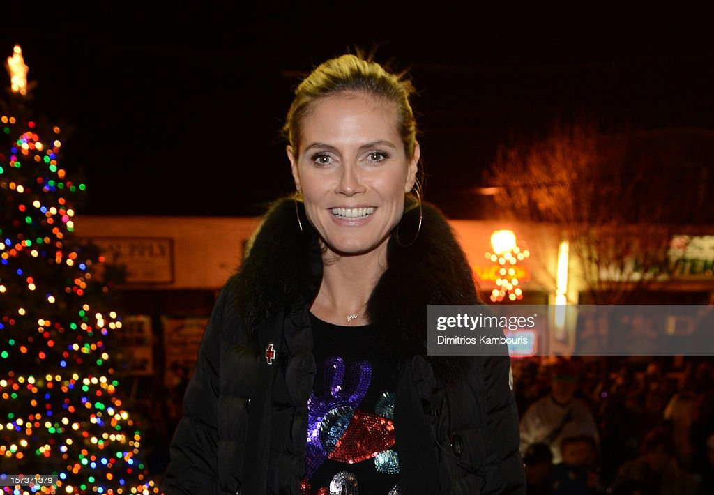 Model Heidi Klum participates in a tree lighting ceremony as she teams up with friends at AOL, Patch and The American Red Cross to benefit Hurricane Sandy relief efforts at American Red Cross and Patch Sites on December 2, 2012 in Lindenhurst, New York.