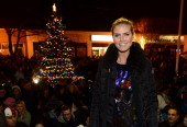 Model Heidi Klum participates in a tree lighting ceremony as she teams up with friends at AOL Patch and The American Red Cross to benefit Hurricane...