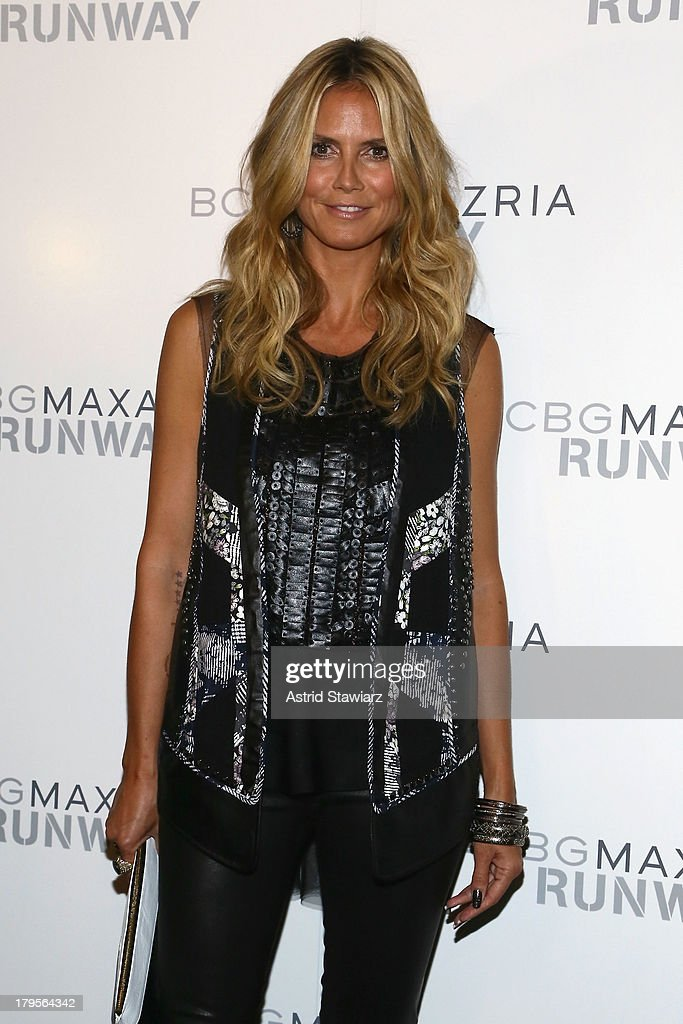 Model Heidi Klum poses backstage at the BCBGMAXAZRIA Spring 2014 fashion show during Mercedes-Benz Fashion Week at The Theatre at Lincoln Center on September 5, 2013 in New York City.