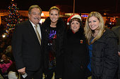 Model Heidi Klum poses for a photograph with Village of Lindenhurst Mayor Thomas A Brennan and his family during a tree lighting ceremony as they...
