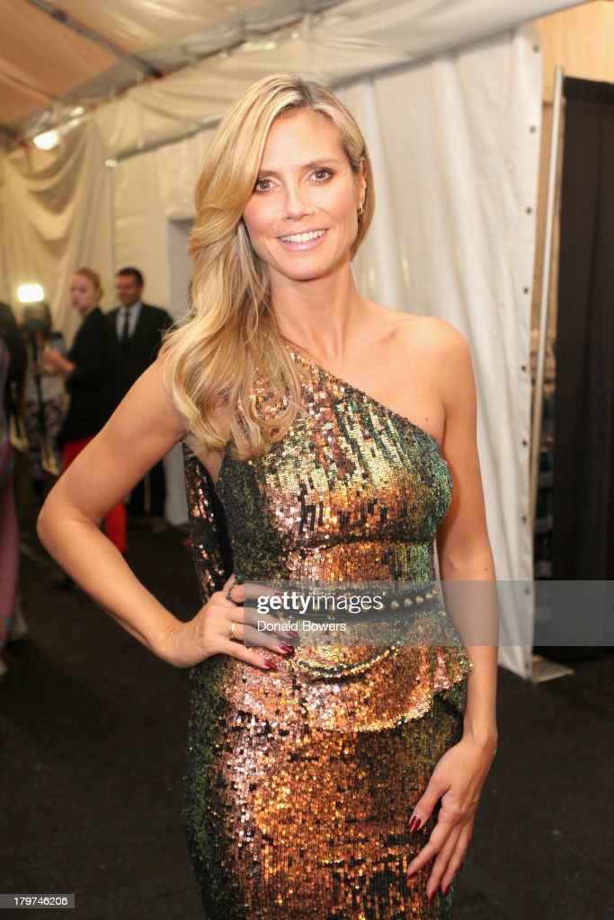Model Heidi Klum poses outside the Samsung Galaxy Blue Room at Mercedes-Benz Fashion Week Spring 2014 Collections at Lincoln Center on September 6, 2013 in New York City.