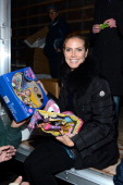 Model Heidi Klum teams up with friends at AOL Patch and The American Red Cross to benefit Hurricane Sandy relief efforts at American Red Cross and...