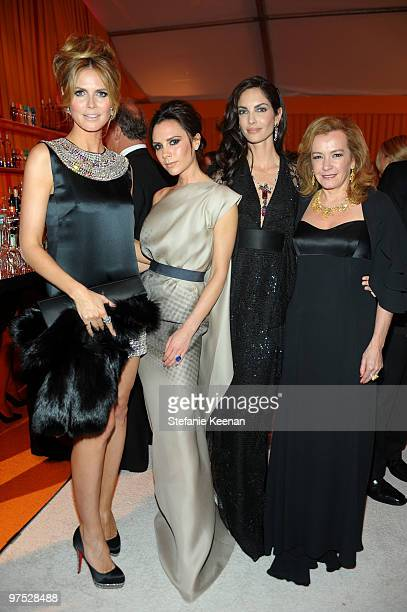 Model Heidi Klum Victoria Beckham Eugenia Silva and CoPresident of Chopard Caroline GruosiScheufele wearing Chopard attend the 18th Annual Elton John...