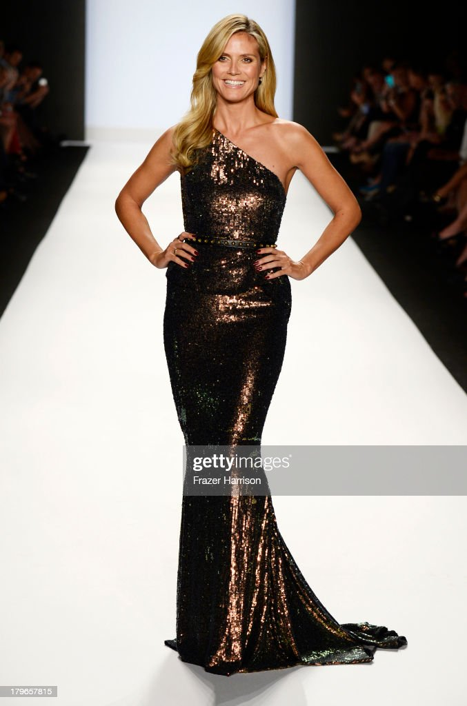 Model <a gi-track='captionPersonalityLinkClicked' href=/galleries/search?phrase=Heidi+Klum&family=editorial&specificpeople=178954 ng-click='$event.stopPropagation()'>Heidi Klum</a> walks the runway at the Project Runway Spring 2014 fashion show during Mercedes-Benz Fashion Week at The Theatre at Lincoln Center on September 6, 2013 in New York City.