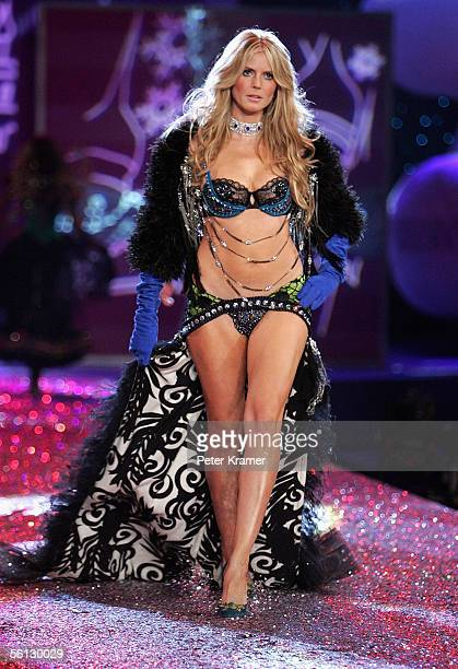 Model Heidi Klum walks the runway at The Victoria's Secret Fashion Show at the 69th Regiment Armory November 9 2005 in New York City