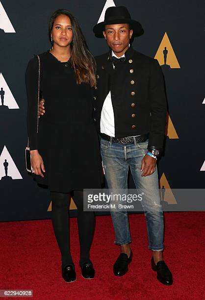 Model Helen Lasichanh and recording artist Pharrell Williams attend the Academy of Motion Picture Arts and Sciences' 8th annual Governors Awards at...