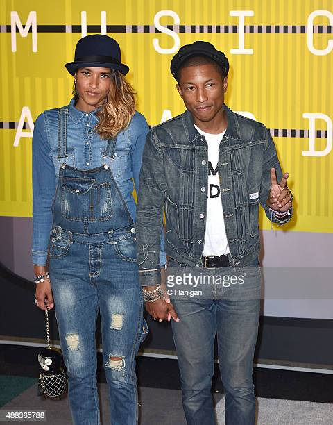 Model Helen Lasichanh and singersongwriter Pharrell Williams arrive to the 2015 MTV Video Music Awards at Microsoft Theater on August 30 2015 in Los...