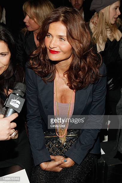 Model Helena Christensen attends the Edun fall 2012 fashion show during MercedesBenz Fashion Week at Hudson River Park's Pier 57 on February 12 2012...