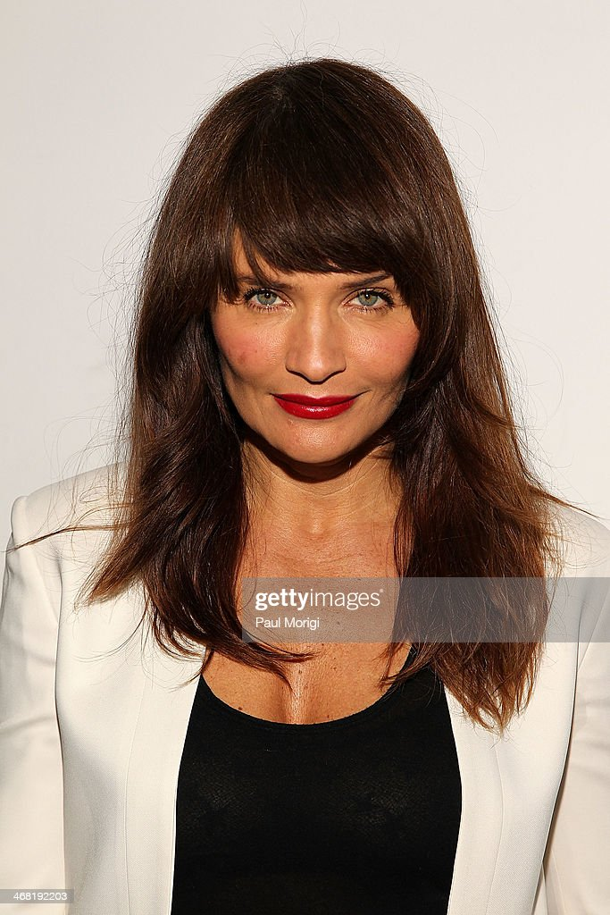 Model Helena Christensen attends the Edun show during Mercedes-Benz Fashion Week Fall 2014 at Skylight Modern on February 9, 2014 in the Brooklyn borough of New York City.