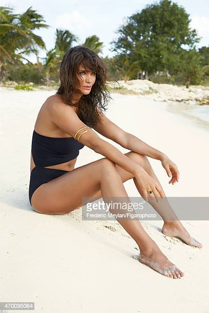Model Helena Christensen is photographed for Madame Figaro on March 20 2015 in Guadeloupe Saint Martin Beauty by Dior Swimsuit bracelet ring...