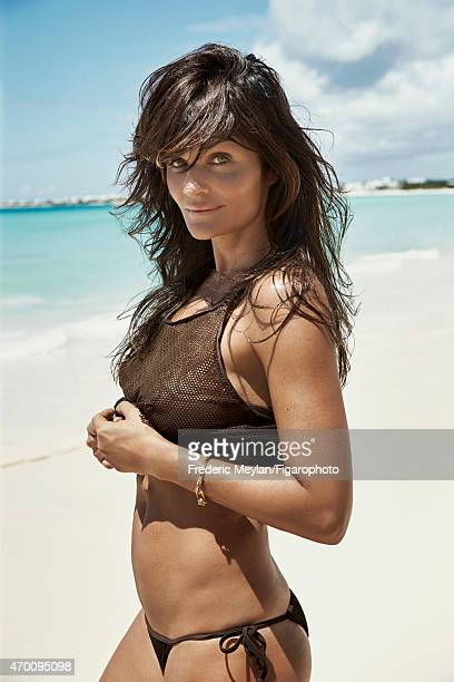 Model Helena Christensen is photographed for Madame Figaro on March 20 2015 in Guadeloupe Saint Martin Beauty by Dior Bikini bottoms top bracelet...