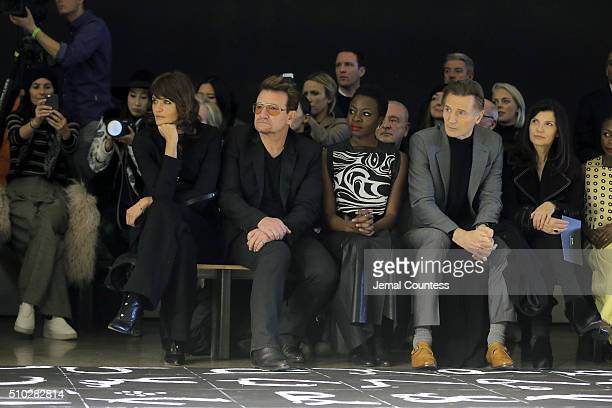 Model Helena Christensen music artist Bono author Danai Gurira actor Liam Neeson and activist Ali Hewson attend the front row during the Edun Fall...