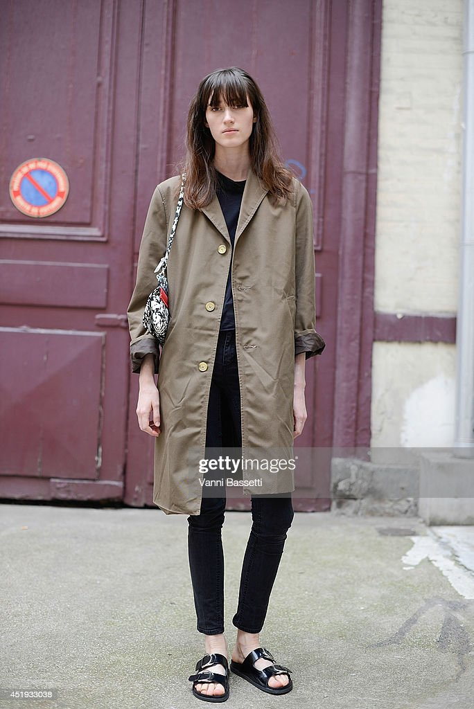 Model Helena Severin poses wearing a vintage coat, Cheap Monday shirt and pants, Zara shoes and Wali Mohammed Barrech bag after Maison Martin Margiela show on July 9, 2014 in Paris, France.
