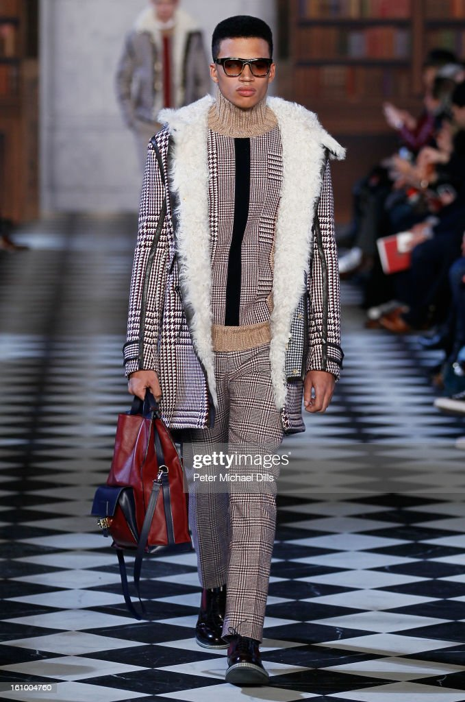 Model Henry Pedro-Wright walks the runway at Tommy Hilfiger Men's Fall 2013 fashion show during Mercedes-Benz Fashion Week at Park Avenue Armory on February 8, 2013 in New York City.