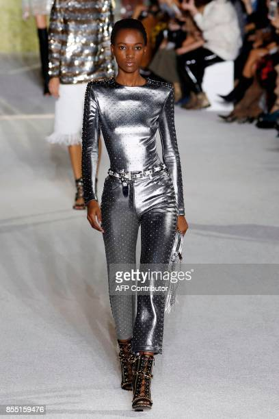 Model Herieth Paul presents a creation for Balmain during the women's 2018 Spring/Summer readytowear collection fashion show in Paris on September 28...