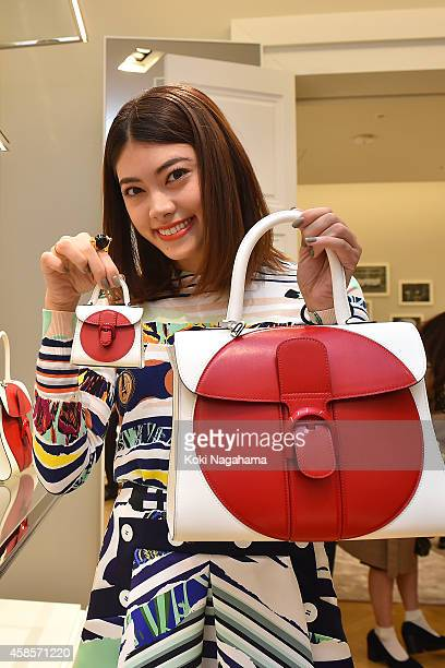 Model Hikari Mori attends the Delvaux Red Moon Party at Delvaux Omotesando on November 7 2014 in Tokyo Japan