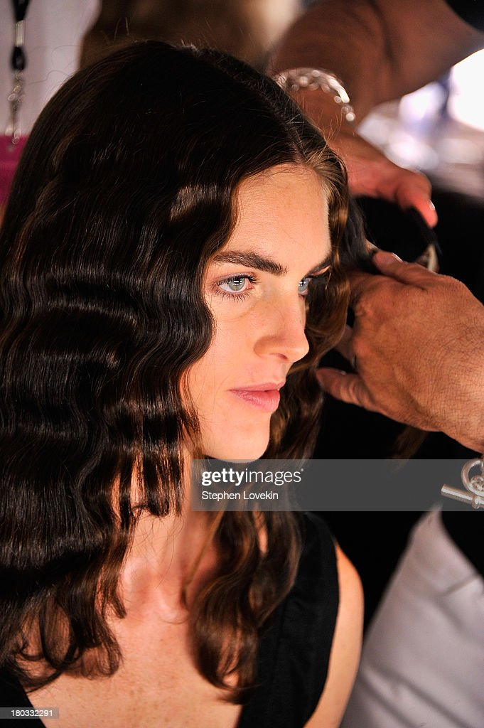 Model Hilary Rhoda prepares backstage at the Anna Sui fashion show during Mercedes-Benz Fashion Week Spring 2014 at The Theatre at Lincoln Center on September 11, 2013 in New York City.