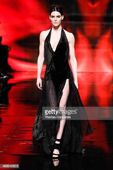 Model Hilary Rhoda walks the runway at Donna Karan New York 30th Anniversary during MercedesBenz Fashion Week Fall 2014 at 23 Wall Street on February...