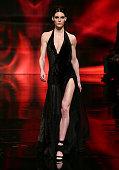 Model Hilary Rhoda walks the runway at the Donna Karan New York 30th Anniversary fashion show during MercedesBenz Fashion Week Fall 2014 on February...