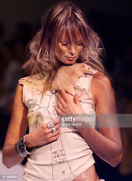 A model holds a rat as she parades fashion by designer Tsubi on day four of Australian Fashion Week in Sydney 10 May 2001 Now in it's sixth year...