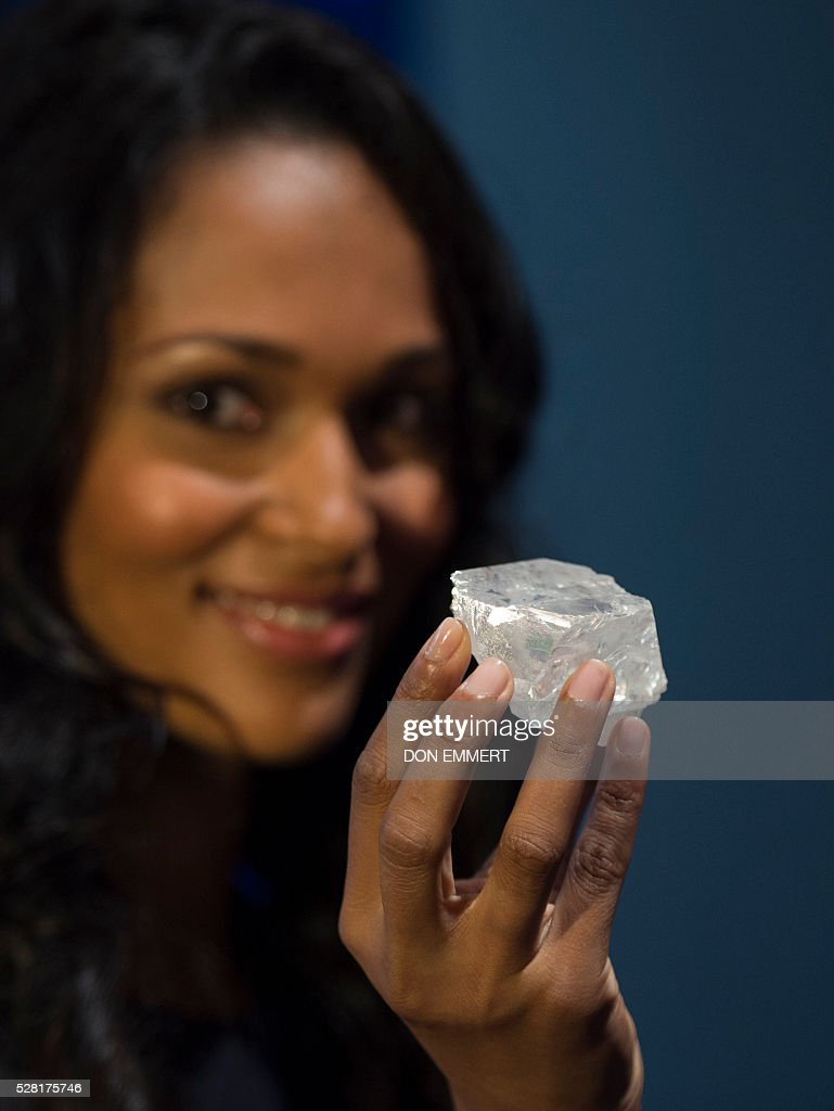 A model holds the 1,109 carat LESEDI LA RONA diamond May 4, 2016 at Sotheby's in New York. The rough diamond, uncovered in Botswana, southern Africa, last year estimated to be three billion years old, will be offered in a stand-alone auction in London on June 29, 2016, estimated to sell for in excess of $70 million USD. EMMERT