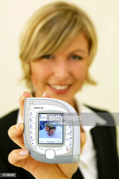 A model holds the new Nokia 7600 mobile phone at the CeBIT technology trade fair March 18 2004 in Hanover Germany The 7600 is both UMTS and GMS...