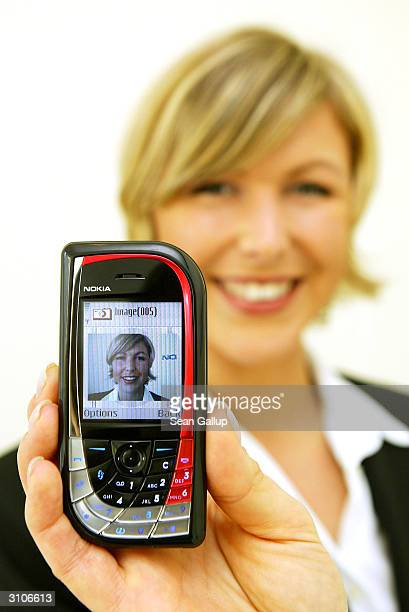 A model holds the new Nokia 7610 mobile phone at the CeBIT technology trade fair March 18 2004 in Hanover Germany The 7610 is among the first phones...