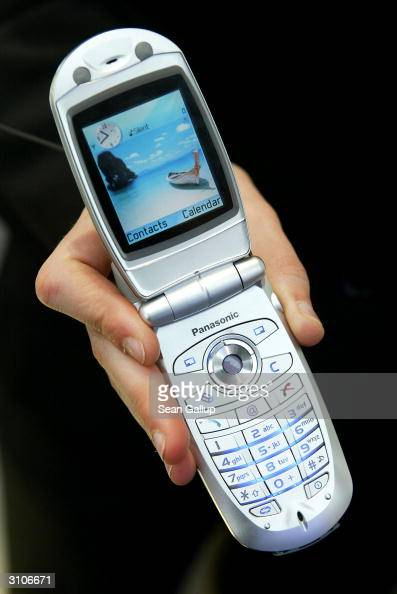 A model holds the new Panasonic X700 mobile phone at the CeBIT technology trade fair March 18 2004 in Hanover Germany The X700 incorporates both a...