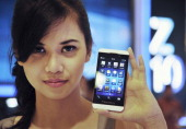 A model holds the newly launched Blackberry Z10 at a shopping mall in Jakarta on March 15 2013 BlackBerry launched its new Z10 smartphone in...