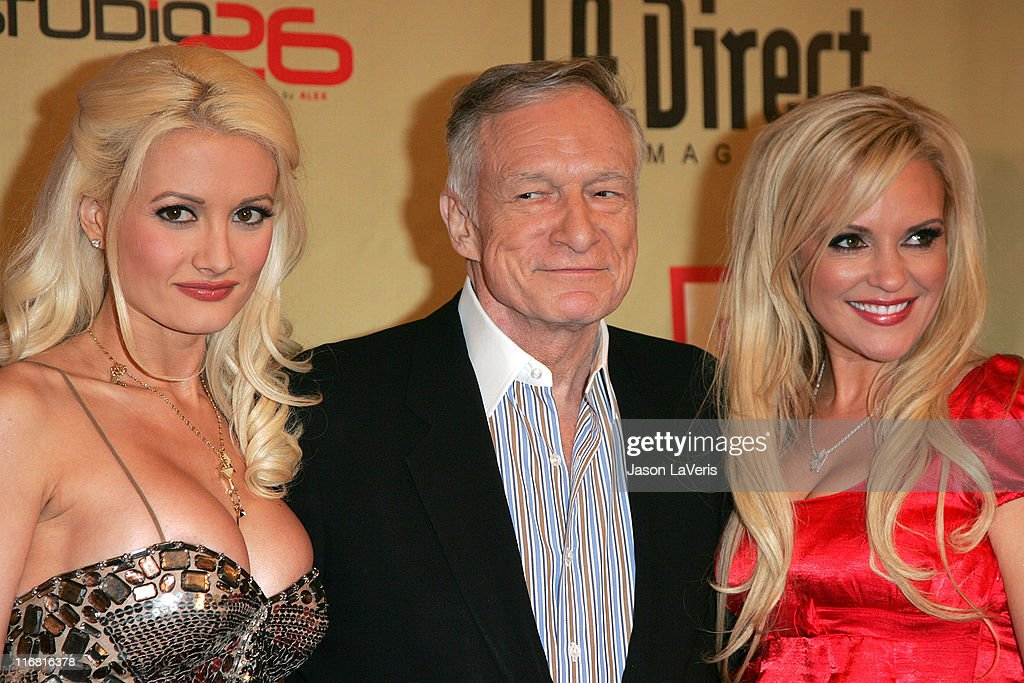 Model Holly Madison, Hugh Hefner and model Bridget Marquardt at the LA Direct Magazine Holiday Party at Le Deux Nightclub in Hollywood, California on December 13, 2007.