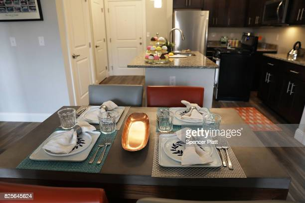 A model home is decorated for perspective renters to view at Canal Crossing a luxury apartment community consisting of 393 rental units near the...
