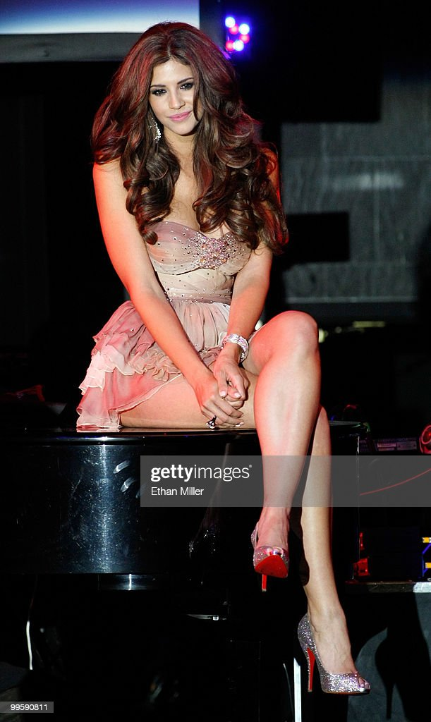 Model Hope Dworaczyk sits on a piano during a performance by singer Robin Thicke at a party introducing her as the 2010 Playboy Playmate of the Year at the Rain Nightclub inside the Palms Casino Resort May 15, 2010 in Las Vegas, Nevada.