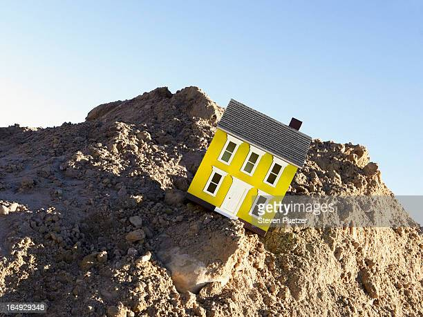 Model house falling off cliff