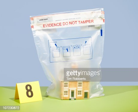 Model house in evidence bag and crime scene number