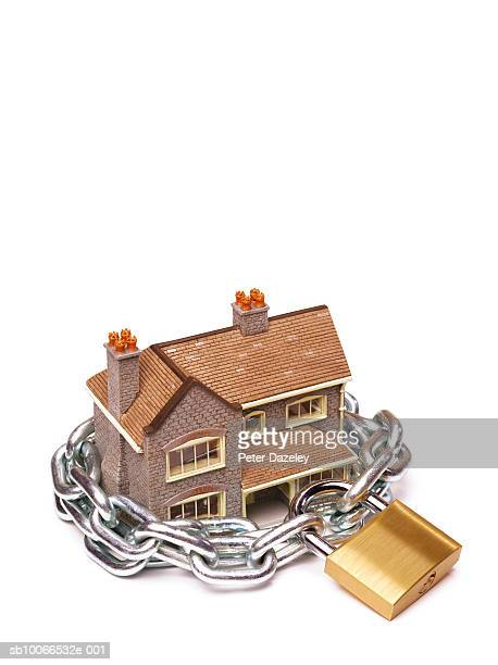Model house protected by padlock and chain