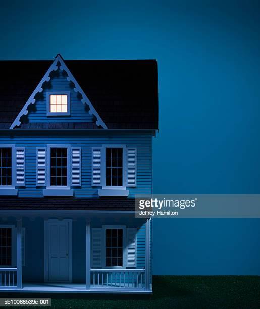 Model house with attic illuminated, close-up