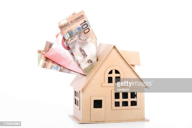 Model house with money inside it