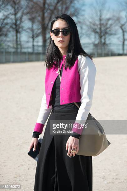 Model Hsin Yu wears Komono sunglasses Shiatzy Chen jacket Cos culottes and Celine bag on day 4 of Paris Collections Women on March 06 2015 in Paris...