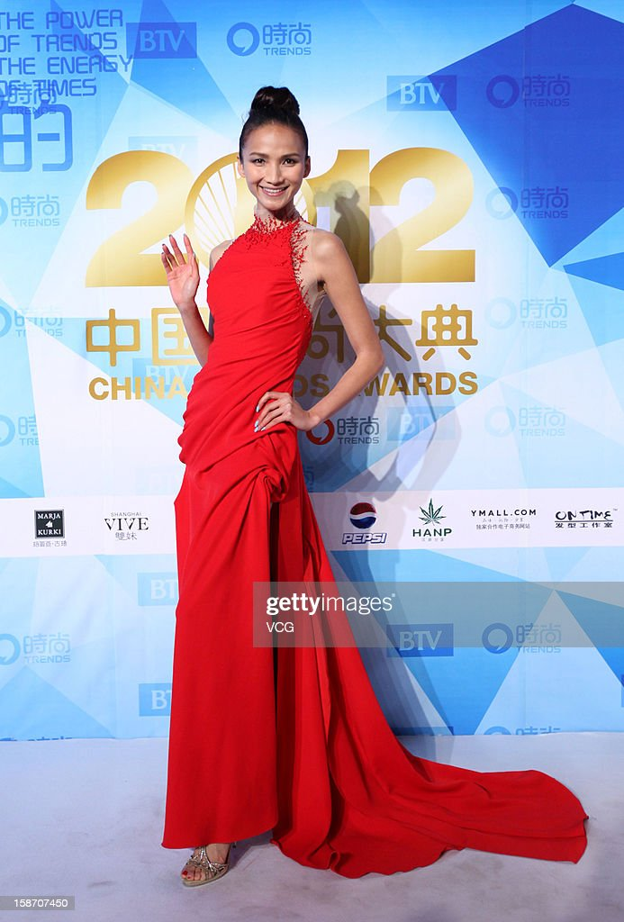 Model Huang Chaoyan arrives at the red carpet of the 2012 China Trends Awards at BTV Grand Theater on December 22, 2012 in Beijing, China.